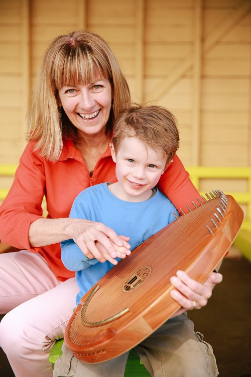 Julie with a boy and harp