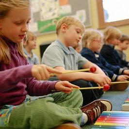 class of children on glockenspiels