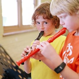 two boys playing recorder